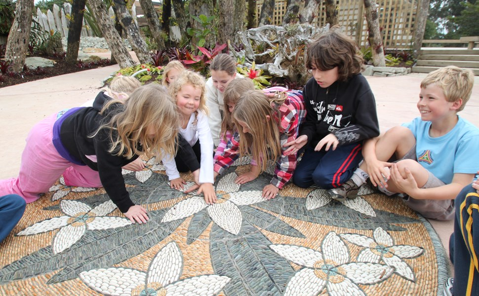 Kids inspecting John Botica's frangipani artwork, Potter Children's Garden